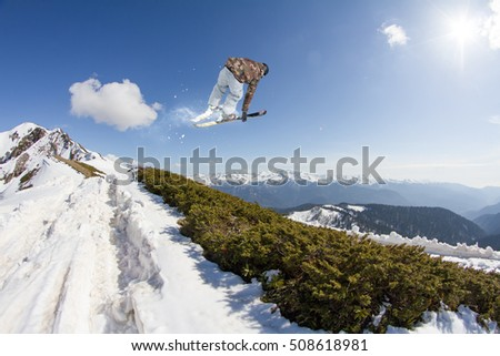 Ski rider jumping on mountains. Extreme freeride sport.