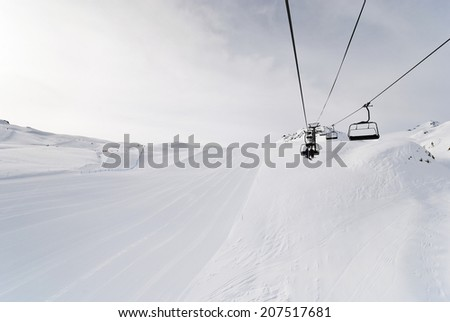 ski run and ski lift on snow slopes of mountains in Paradiski region, Val d'Isere - Tignes , France - stock photo