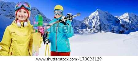 Ski, skier, snow and fun - family enjoying winter vacations - stock photo
