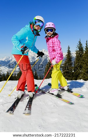 Ski, skier, snow and fun - skiers enjoying winter vacations - stock photo