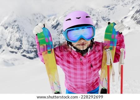 Ski, skier, winter fun - lovely skier girl enjoying ski vacation - stock photo