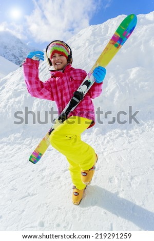Ski, skier, winter - lovely girl has a fun on ski - stock photo