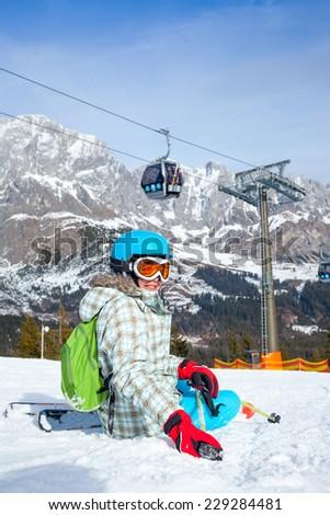 Ski, skier, winter - lovely girl has a fun on ski. Vertical view - stock photo