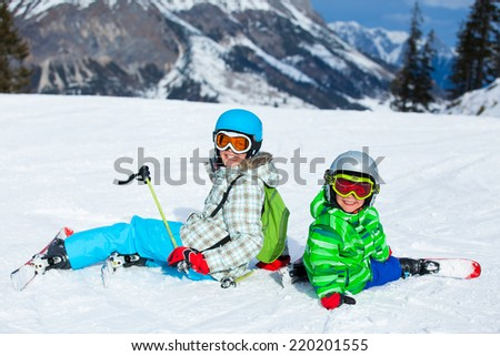 Ski, skier, winter - lovely kids has a fun on ski - stock photo