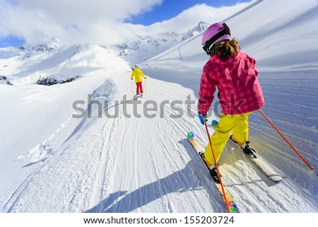 Ski, skiers on ski run - child skiing downhill