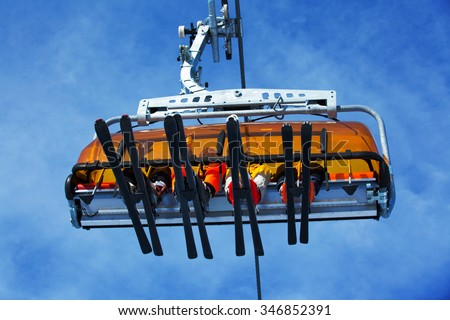 Ski, skiing - family skiers on ski lift - stock photo
