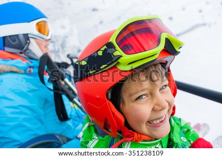 Ski, skiing - Portrait of little skier boy on ski lift - stock photo