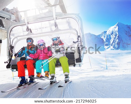 Ski, skiing - skiers on ski lift - stock photo