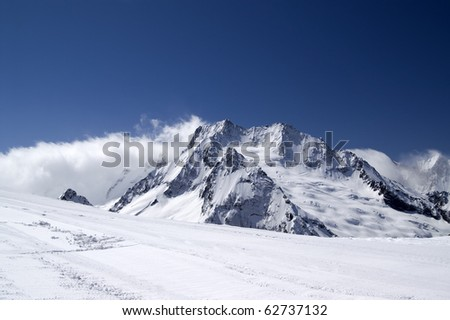 Ski slope against mountains. Caucasus, Dombay. - stock photo