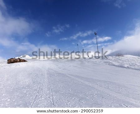 Ski slope and hotel in winter mountains. Georgia, ski resort Gudauri. Caucasus Mountains. - stock photo