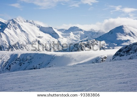Ski slope and panorama of winter mountains. Alpine ski resort Bansko, Bulgaria