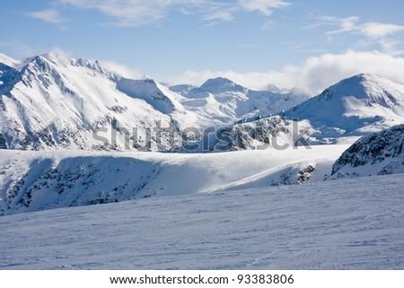 Ski slope and panorama of winter mountains. Alpine ski resort Bansko, Bulgaria - stock photo