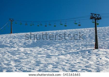 Ski Slope and Ski Lift near Megeve in French Alps, France - stock photo