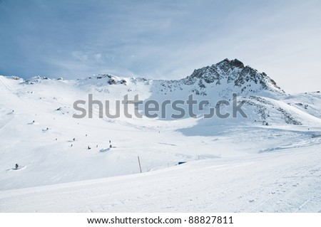 ski slope, huge mountain in background - stock photo