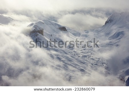 Ski slope in cold weather - stock photo