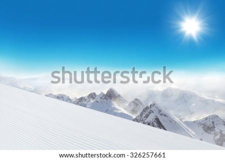 Ski slope in Dolomites mountains - stock photo