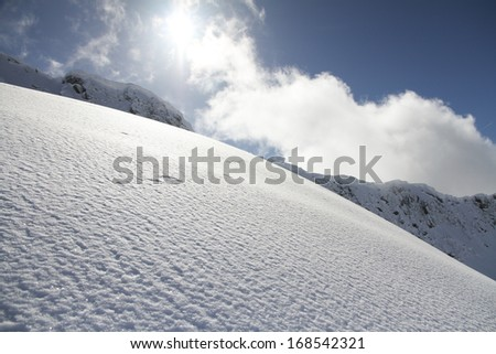 ski slope in powder snow, mountain landscape - stock photo