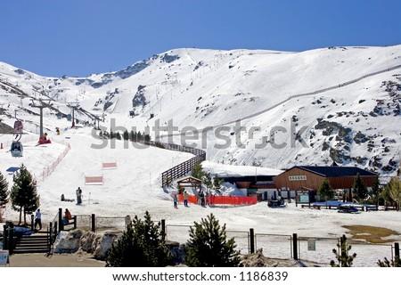 Ski slopes and lifts of Pradollano ski resort in the Sierra Nevada mountains in Spain - stock photo