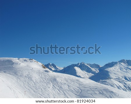 ski slopes and mountain panorama on sunny day St Anton Arlberg Austrian alps - stock photo