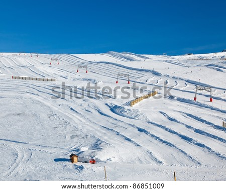 Ski slopes in French Alps - stock photo