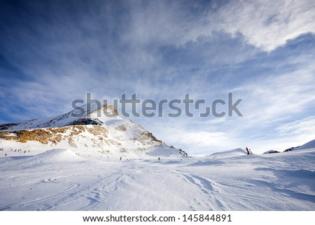 Ski slopes in Kaprun resort next to Kitzsteinhorn peak, Austrian Alps - stock photo