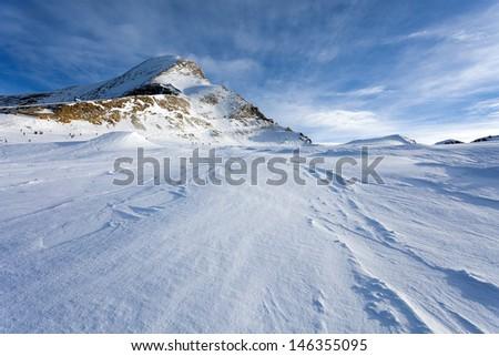 Ski slopes in Kaprun resort next to Kitzsteinhorn peak, Austrian Alps - stock photo