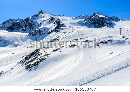 Ski slopes in Pitztal winter mountain resort, Austrian Alps - stock photo