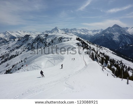 Ski slopes with skiers - stock photo