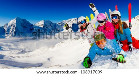 Ski, snow sun and fun - happy family on ski holiday - stock photo
