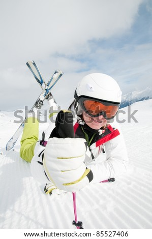 Ski, snow, sun and fun - happy skier in winter resort (space for text, cover)