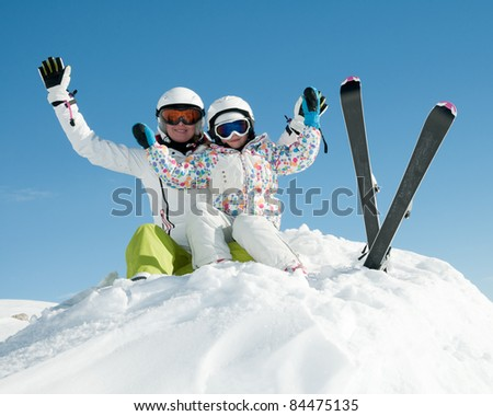 Ski, snow, sun and fun - skiers on winter vacation - stock photo