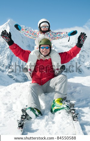 Ski, snow, sun and fun - skiers on winter vacation (cover)