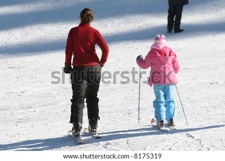 ski teacher and her student