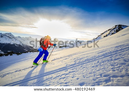 Ski touring in high mountains in fresh powder snow. Snow mountain range. Mt Fort Peak Alps region Switzerland.Wallis