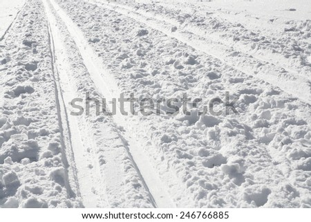 Ski track in white snow
