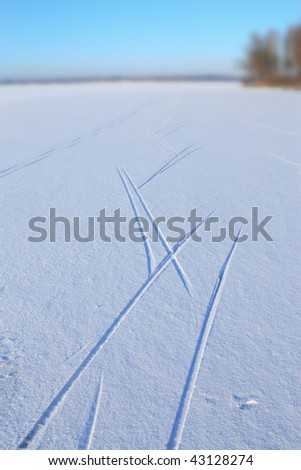 Ski track on snow carrying on afar