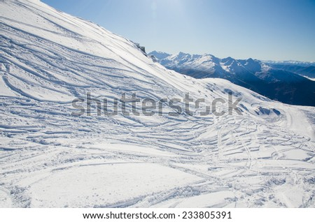 ski tracks in the mountains - stock photo