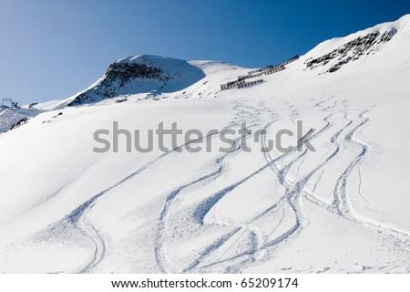 Ski trails on a mountain, off-piste - stock photo