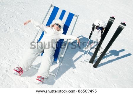 Ski vacation -resting skier in ski resort - stock photo