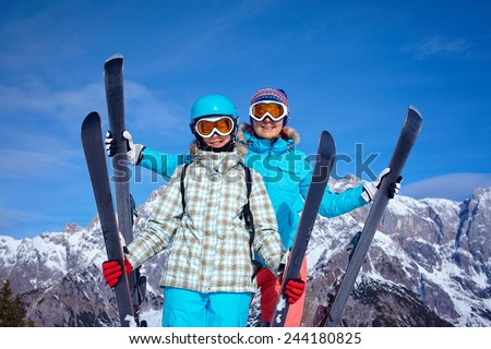 Ski, winter and fun - Family: mother and daughter enjoying winter vacations. - stock photo