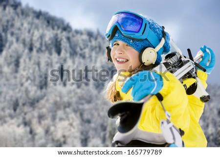 Ski, winter fun - lovely skier girl enjoying ski holiday - stock photo