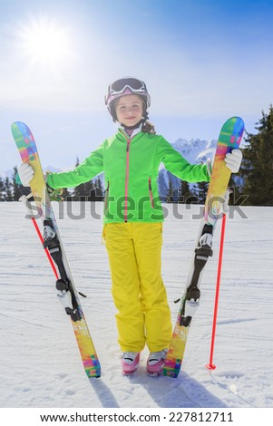 Ski, winter fun - lovely skier girl enjoying ski vacation - stock photo