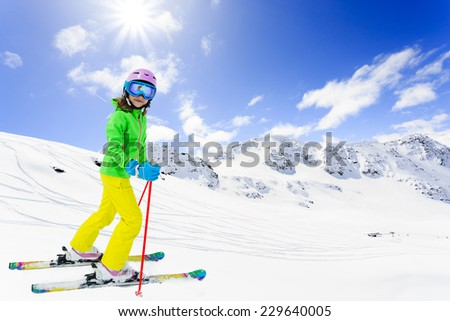 Ski, winter fun - lovely skier girl enjoying skiing - stock photo