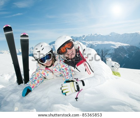 Ski, winter - happy skiers on winter vacation - stock photo