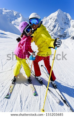 Ski, winter, ski lesson - female skiers on ski run - stock photo
