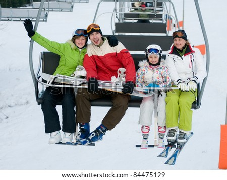 Ski, winter - skiers on ski lift - stock photo