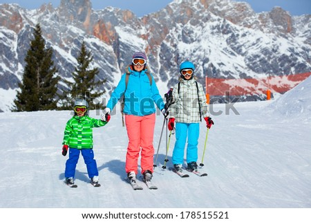 Ski, winter, snow, skiers, sun and fun - family enjoying winter vacations. - stock photo