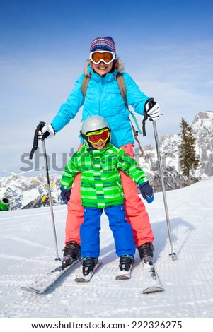 Ski, winter, snow, skiers, sun and fun - Family - mother and son enjoying winter vacations. - stock photo