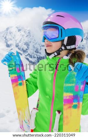 Ski, winter sport - lovely skier girl enjoying ski vacation - stock photo