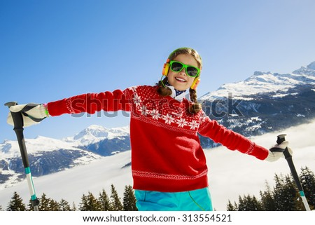 Ski, winter vacation, snow, skier, sun and fun - girl enjoying ski vacation - stock photo